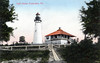 An old postcard view of the Amelia Island Lighthouse showing the old Keepers dwelling.