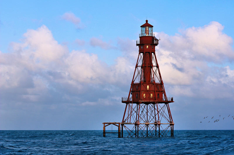 """In 1852 a 36 foot white screwpile structure was erected on the shoal as a day beacon.  The pile was surmounted by a red latticework hoop with the letter """"B"""" painted on black vane."""