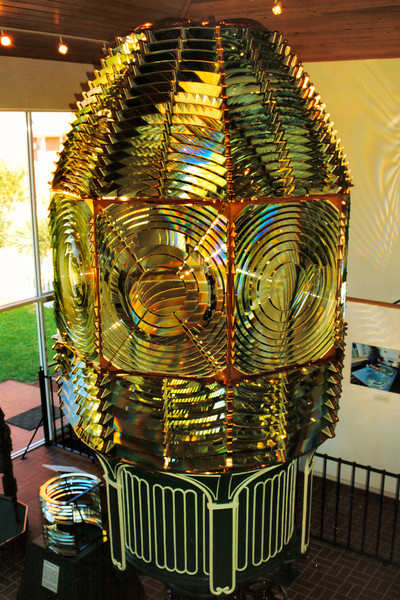 In the early 1990's it was learned that the rocket launches were taking a toll on the 1st Order lens.  Vibrations were shaking loose prisms from the brass framework.  In 1995 the lens was removed from the lantern and moved to the lens exhibit building at the Ponce de Leon Lighthouse and restored.  The lens was replaced with a DCB-224 optic.