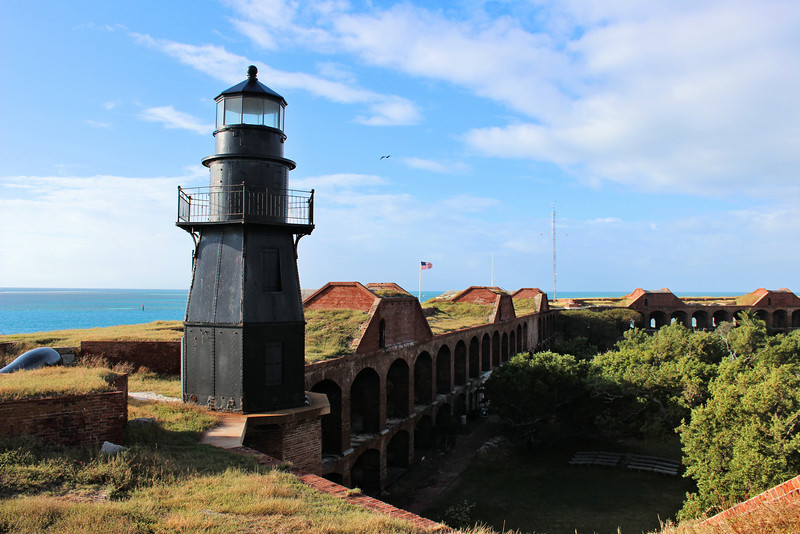 The U.S. military realized the importance of the Dry Tortugas as the key to controlling navigation into the Gulf of Mexico.  The Army drew up plans to begin building a fort on Garden Key; however they were surprised to find a lighthouse in the middle of their planned parade grounds.  The Treasury Dept. had neglected to obtain title to the land their lighthouse stood upon.  An agreement was reached to have the fort built around the lighthouse