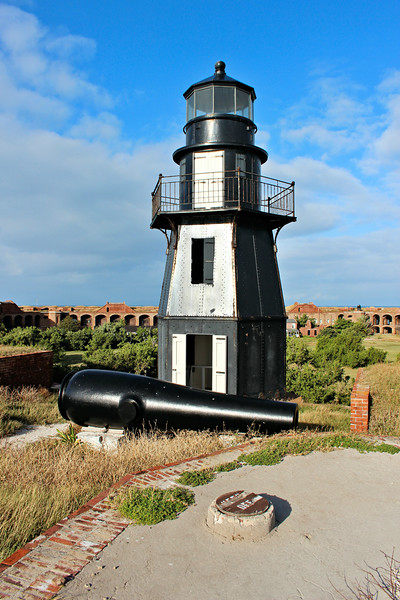 A hurricane in October 1873 damaged both the Garden Key and Loggerhead Key Lighthouses. The Army abandoned Fort Jefferson in early 1874.  In March 1875 Congress appropriated $5,000 to replace the old light with a new tower to be built atop the fort walls.