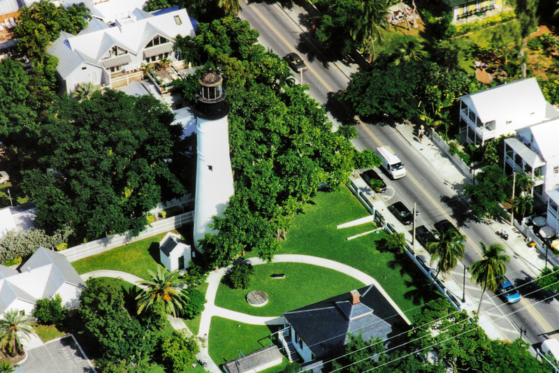 I took this view of the lighthouse grounds from an open biplane wearing a leather helmet.  Barnstorming the Keys!