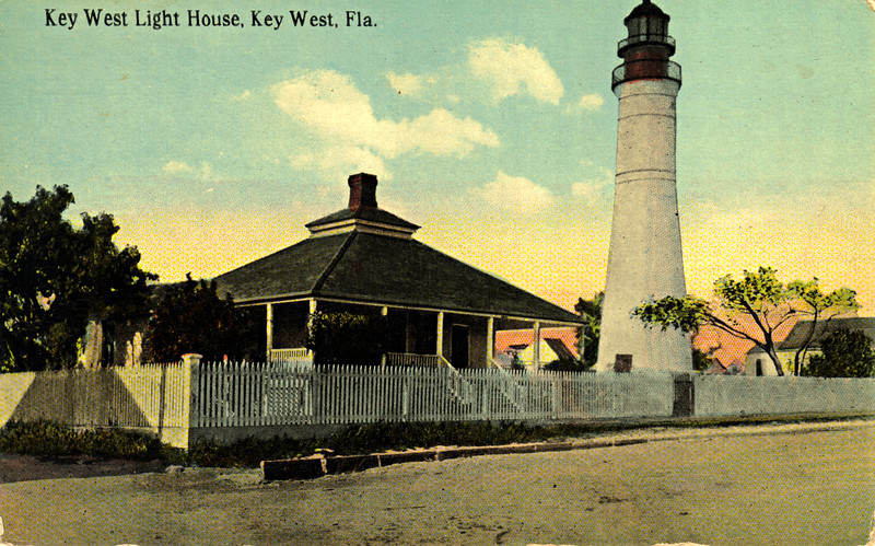 A turn of the century view of the lighthouse grounds from Whitehead Street.  Across the street is located the Ernest Hemingway house and further down the street is the Green Parrot Bar and the infamous Duval Street.  See kwahs.org/visit/lighthouse-keepers-quarters/visit for more information.