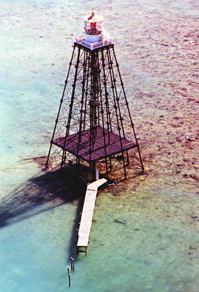 A lightship named the 'Honey' was sent to the site to stand watch for the next seven years until a new lighthouse could be built.  I.W.P. Lewis was tasked by the Lighthouse Board to design a new lighthouse for the unstable site.  He designed an open-framed wrought-iron screwpile structure which would be secured to the reef.