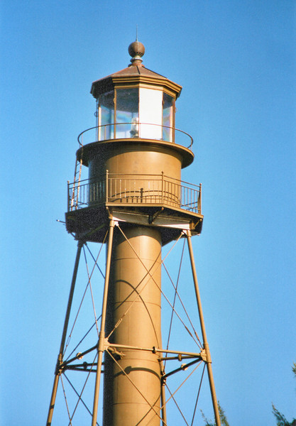 The 10 sided lantern housed a Third Order Fresnel lens which exhibited a flashing pattern.  The 75 pound weight which rotated the lens needed to be wound once every two hours.  The lamp would burn an average of two gallons of kerosene each night.