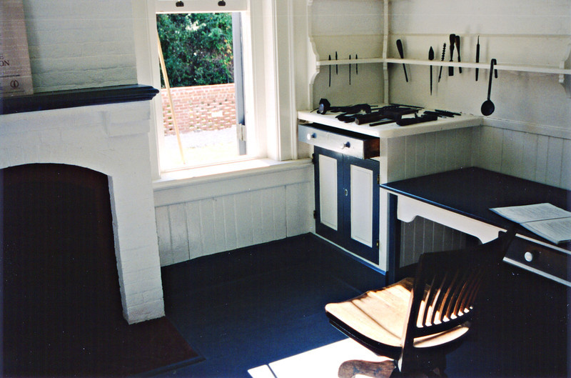 *A view of the Keepers workroom at the bottom of the tower* A new duplex was constructed just east of the new tower for the living quarters of the Keeper, his two assistants and their families in 1876.  The Keeper lived on the north side of the building and the first assistant keeper lived on the south side of the duplex.  The second assistant keeper was assigned two rooms on the top floor. The bedrooms were on the top floor and downstairs were the living room and the dining room.  A summer kitchen for cooking in the warm weather was located in a separate building in 1886.
