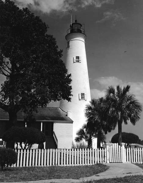 Charles Fine served as Keeper from 1892 thru 1904 and his daughter Sarah married John Gresham who became Keeper in 1916.  During his tenure the St. Marks Migratory Bird Refuge was created in 1931 and a road was built to the lighthouse.  In 1957 Gresham's son Alton succeeded him as Keeper and served until automation of the light in 1960.  In 1974 the St. Marks Lighthouse was placed on the National Register of Historic Places.  The Fresnel lens was replaced with a modern optic in 2000.  In 2010 ownership was transferred from the Coast Guard to the U.S. Fish and Wildlife Service.