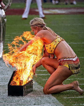 Twirler alum April Donelson is momentarily engulfed in flames as the she places the batons in the firebox.  Donelson was not injured and continued to perform. The #2 ranked Florida State Seminoles dominated Syracuse 59-3 Saturday at Doak Campbell stadium.  The Seminoles complete the 2013 home stand next weekend against Idaho before travelling to Gainesville to close out the regular season.