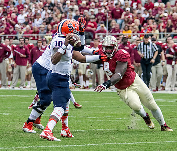 Timmy Jernigan puts pressure on Syracuse QB Terrel Hunt as the #2 ranked Florida State Seminoles dominated Syracuse 59-3 Saturday at Doak Campbell stadium.  The Seminoles complete the 2013 home stand next weekend against Idaho before travelling to Gainesville to close out the regular season.