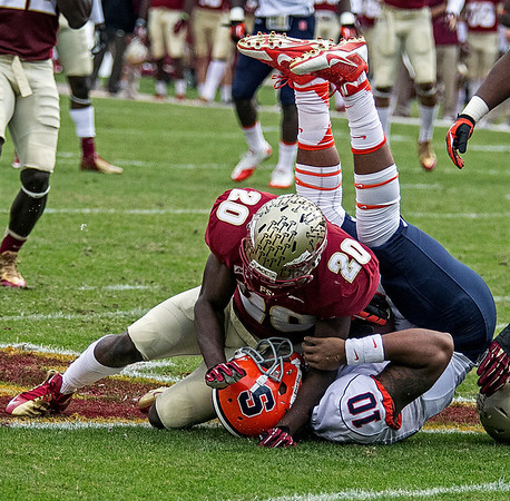 Lamarcus Joyner tackles Syracuse QB Terrel Hunt early in the first quarter.  The #2 ranked Florida State Seminoles dominated Syracuse 59-3 Saturday at Doak Campbell stadium.  The Seminoles complete the 2013 home stand next weekend against Idaho before travelling to Gainesville to close out the regular season.
