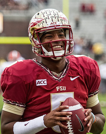 QB Jameis Winston flashes his Magic Johnsonesque smile as he warms up for the game . Winston was 19 for 21 - 277 yards - 2 TD's.  The #2 ranked Florida State Seminoles dominated Syracuse 59-3 Saturday at Doak Campbell stadium.  The Seminoles complete the 2013 home stand next weekend against Idaho before travelling to Gainesville to close out the regular season.