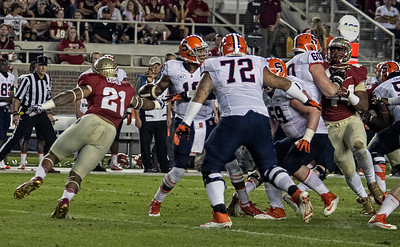 Defensive end Chris Casher catches Syracuse QB Terell Hunt and forces a fumble.  Casher picked up the loose ball and ran 31 yards for an FSU TD as the #2 ranked Florida State Seminoles dominated Syracuse 59-3 Saturday at Doak Campbell stadium.  The Seminoles complete the 2013 home stand next weekend against Idaho before travelling to Gainesville to close out the regular season.