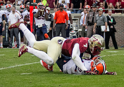 LB Christian Jones makes Syracuse QB Terrel Hunt pay for a completion late in the game as the #2 ranked Florida State Seminoles dominated Syracuse 59-3 Saturday at Doak Campbell stadium.  The Seminoles complete the 2013 home stand next weekend against Idaho before travelling to Gainesville to close out the regular season.