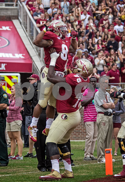 Devonta Freeman celebrates with Cam Erving after his 60 yd TD run.  Freeman finished the day with 131 yards on only 11 carries.  The Seminoles set a school record for most points scored as they dominated Idaho 80-14 in the last home game of the season.