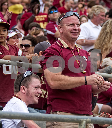 Payton Poulin and his father Patrick enjoy the game Saturday as the Seminoles set a school record for most points scored as they dominated Idaho 80-14 in the last home game of the season.  Payton is a freshman at Florida State and frequents the practice field daily as the Seminoles practiced throughout the season.