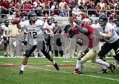Christian Jones and Tim Jernigan apply pressure on Idaho QB Taylor Davis.  Florida State set a school record for most points scored as they dominated Idaho 80-14 in the last home game of the season.