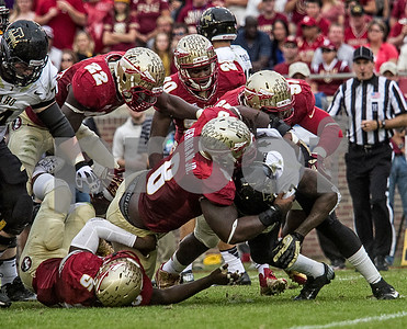 Idaho RB James Baker has no where to go as Tim Jernigan and the defensive line swallow up Baker behind the line of scrimmage.  The Seminoles defeated the University of Idaho 80-14 in the home finale.