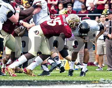 Mario Edwards Jr wraps up Idaho QB Joshua McCain Saturday as Florida State set a school record for most points scored as they dominated Idaho 80-14 in the last home game of the season.
