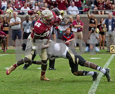 Telvin Smith intercepts a pass and returns it 79 yards for a TD.  Florida State set a record for points scored in the final home game of the season at Doak Campbell stadium as the Seminoles dominated Idaho 80-14.