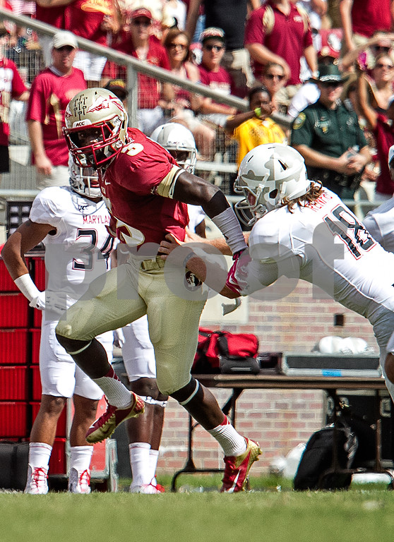 "Freshman WR and PR Jesus ""Bobo"" Wilson returns a punt 36 yards and is only stopped by Maryland punter Nathan Renfro.  The Florida State Seminoles crushed the Maryland Terrapins 63-0 Saturday at Doak Campbell stadium."