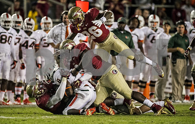 Christian Jones, Timmy Jernigan, and PJ Williams swarm Miami running back Duke Johnson as the #3 Florida State Seminoles defeated the #7 ranked Miami Hurricanes 41-14 Saturday night in a top 10 ACC match-up of unbeaten teams.