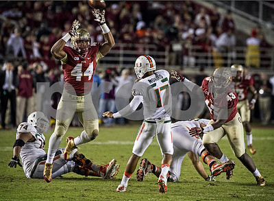 DE Demarcus Walker nearly blocks a pass by Miami QB Stephen Morris as the #3 Florida State Seminoles defeated the #7 ranked Miami Hurricanes 41-14 Saturday night in a top 10 ACC match-up of unbeaten teams.