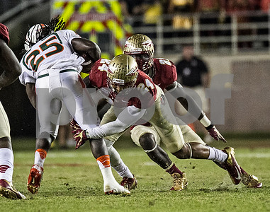 Terrence Smith brings down Miami RB Dallas Crawford as the #3 Florida State Seminoles defeated the #7 ranked Miami Hurricanes 41-14 Saturday night in a top 10 ACC match-up of unbeaten teams.