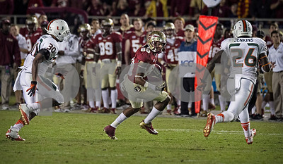 Rashad Greene splits two defenders in route to a first down Saturday night as the #3 Florida State Seminoles defeated #7 Miami 41-14.
