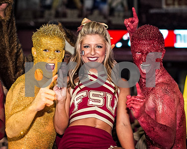 An FSU Cheerleader poses with the Garnet & Gold guys after Saturday's win over #7 ranked Miami.  The win catapulted the Seminole to #2 in the Monday's BCS rankings.