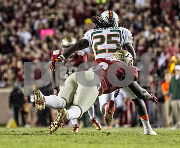 DE Dan Hicks catches Miami running back Dallas Crawford from behind for a short gain as the #3 Florida State Seminoles defeated the #7 ranked Miami Hurricanes 41-14 Saturday night in a top 10 ACC match-up of unbeaten teams.