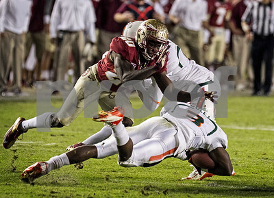 Lamarcus Joyner makes the tackle on Miami's Stacy Coley during a kick return as the #3 Florida State Seminoles defeated the #7 ranked Miami Hurricanes 41-14 Saturday night in a top 10 ACC match-up of unbeaten teams.