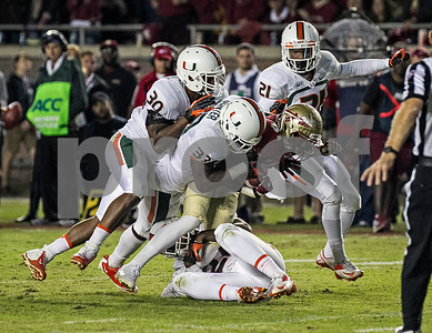Kenny Shaw carries defenders for a first down Saturday night as the #3 ranked Florida State Seminoles defeated the #7 ranked Miami Hurricanes 41-14. Shaw had 3 receptions for 44 yards in the victory over Miami.