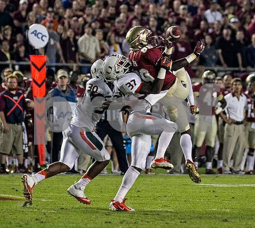 Christian Green has a pass broken up by Miami defensive backs Ladarius Gunter and Alex Irastorza.  #3 Florida State defeated the #7 ranked Miami Hurricanes 41-14 Saturday night in a top 10 ACC match-up of unbeaten teams.
