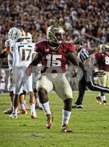 Defensive end Mario Edwards Jr celebrates his sack of Miami QB Stephen Morris on 3rd down as the Hurricanes were forced to punt. #3 Florida State Seminoles defeated the #7 ranked Miami Hurricanes 41-14 Saturday night in a top 10 ACC match-up of unbeaten teams.