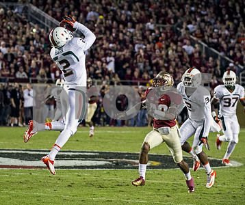 Rashad Greene can only watch as a pass sails high and Miami's Deon Bush intercepts.  The #3 Florida State Seminoles defeated the #7 ranked Miami Hurricanes 41-14 Saturday night in a top 10 ACC match-up of unbeaten teams.