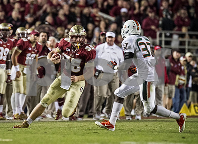 Nick O'Leary looks to initiate contact with Miami defensive back Ladarius Gunter as the #3 Florida State Seminoles defeated the #7 ranked Miami Hurricanes 41-14 Saturday night in a top 10 ACC match-up of unbeaten teams.