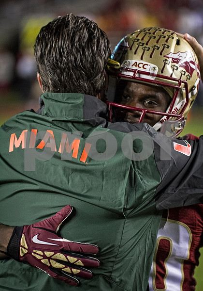 Lamarcus Joyner and former offensive coordinator James Coley share a hug during pre-game warm ups Saturday. Joyner was recruited to Florida State by Coley.  Coley returned to Doak Campbell stadium for the first time since becoming offensive coordinator at Miami.  Coley is responsible for much of the talent at Florida State as he served as recruiting coordinator and recruited the Miami area. The #3 ranked Florida State Seminoles defeated the #7 ranked Miami Hurricanes 41-14 Saturday night in a top 10 ACC match-up of unbeaten teams.