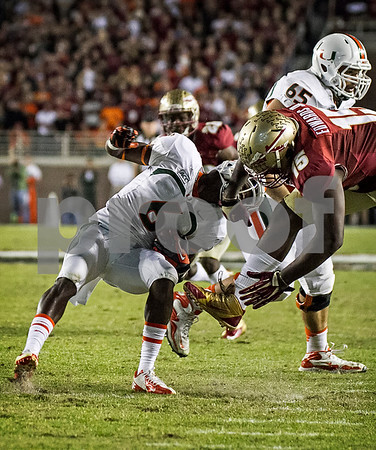DE Mario Edwards Jr takes down Miami WR Herb Waters Saturday as the #3 ranked Seminoles faced the #7 Miami Hurricanes.