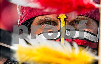 Chief Osceola peers through the feathers of his spear Saturday as the Seminoles welcomed the Nevada Wolfpack to Doak for their 2013 home opener.  The Seminoles defeated the Wolfpack 62-7 as the high powered offense chalked up another very impressive performance.