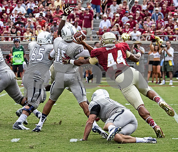 Defensive End Demarcus Walker applies pressure from behind as Demonte McAllister attempts to block a pass by Nevada back-up QB Tyler Stewart.  Stewart started in place of injured QB Cody Fajardo. Florida State defeated the University of Nevada 62-7 Saturday as Florida State improved to 2-0 on the season.