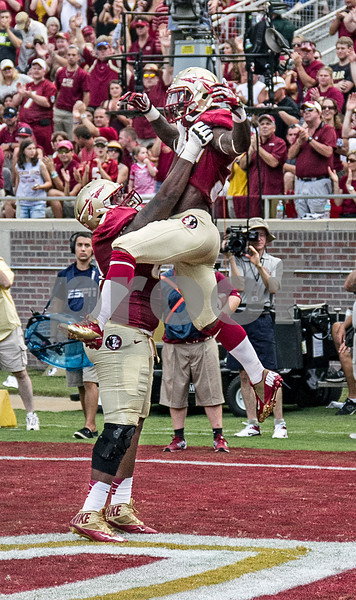 James Wilder Jr and OL Bobby Hart celebrate after Wilder's TD.  Wilder finished with 45 yards on 6 carries. The Seminoles defeated the Wolfpack 62-7 Saturday as Florida State improved to 2-0 on the season.