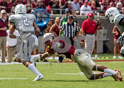 DB Ronald Darby looks to make a shoestring tackle on Nevada WR Richy Turner.  The Seminoles defeated the Wolfpack Saturday 62-7.