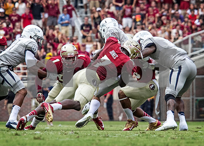 LB Christian Jones tackles Nevada WR Richy Turner as the Seminoles defeated the Wolfpack 62-7 in Saturday's home opener at Doak Campbell stadium.