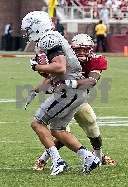 Freshman DB Jalen Ramsey tackles Nevada TE Kolby Arendse Saturday in the Seminole's home opener at Doak Campbell stadium.  Florida State defeated the University of Nevada 62-7 to improve to 2-0 on the season.