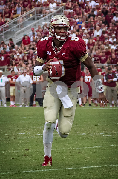 QB Jameis Winston runs for a touchdown Saturday against the Nevada Wolfpack. Winston was 15 of 18 for 214 yards and 2 TDs.  Florida State defeated Nevada 62-7 Saturday at Doak Campbell stadium.