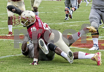 DE Mario Edwards Jr tackles Nevada WR Brandon Wimberly for a loss on an end around and loses his facemask in the process. The Seminoles defeated the University of Nevada 62-7 Saturday as Florida State improved to 2-0 on the season.