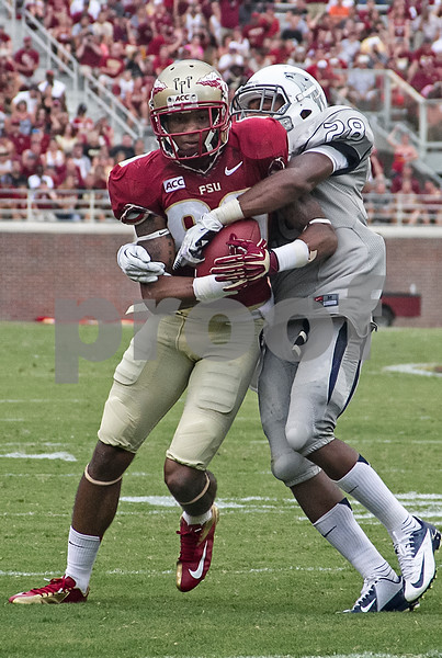 WR Rashad Greene works for more yardage after a reception Saturday.  Greene had 3 receptions for 39 yds and 1 TD.   The Seminoles defeated the University of Nevada 62-7 Saturday as Florida State improved to 2-0 on the season.