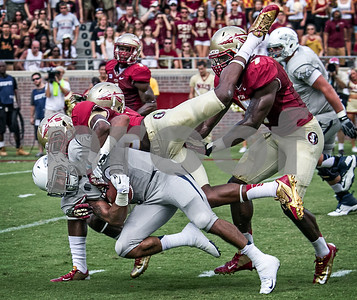 Ronald Darby tackles RB Chris Solomon with a little help from Christian Jones and Terrance Brooks in Saturdays game against the Nevada Wolfpack.
