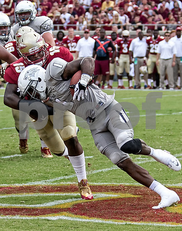 DE Mario Edwards Jr tackles Nevada WR Brandon Wimberly for a loss on an end around.  The Seminoles defeated the University of Nevada 62-7 Saturday as Florida State improved to 2-0 on the season.