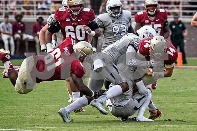 2nd team OL Myles Davis flies through the air trying to assist QB Jacob Coker as he rushes for 12 yards during Saturday's game against the Nevada Wolfpack.  Florida State defeated Nevada 62-7 to improve to 2-0 on the season.